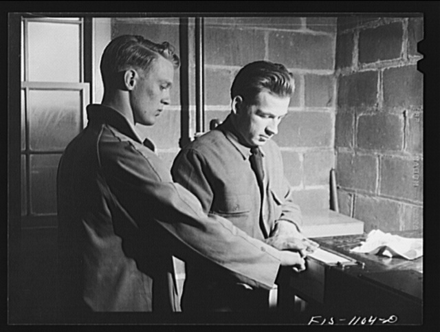 Swedish-American selectee in Minnesota being fingerprinted as he is inducted into the U.S. armed forces