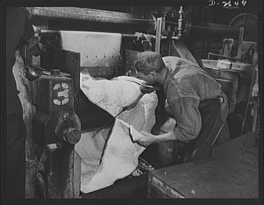 Synthetic rubber (Ameripol). This sheet of synthetic rubber coming off the rolling mill at the Akron, Ohio plant of the B.F. Goodrich Company is now ready for drying