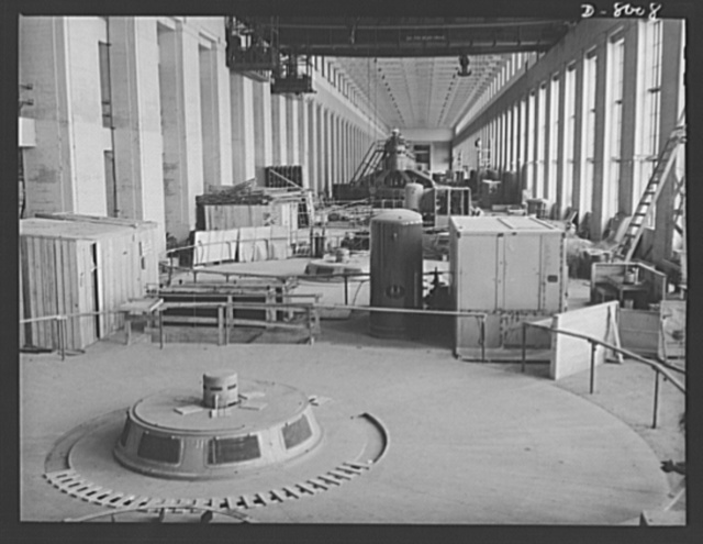 Tennessee Valley Authority. A cover plate and exciter housing of a new generator unit in place at TVA's hydroelectric plant at Wilson Dam. Completed units show in the background. Located near Sheffield, Alabama, 260 miles above the the mouth of the Tennessee River, the dam had an authorized power installation of 288,000 kilowatts, which can be increased to a possible ultimate of 444,000 kilowatts. The reservoir at the dam adds 377,000 acre feet of water to controlled storage on the Tennesse River system