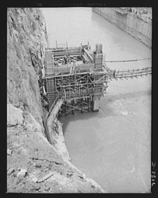 Tennessee Valley Authority. Construction of Douglas Dam. Caisson construction on TVA's new Douglas Dam on the French Broad River. This dam will be 161 feet high and 1,682 feet long, with a 31,600 acre reservoir area extending forty-three miles upstream. With a useful storage capacity of approximately 1,330,000 acre-feet this reservoir will make possible the addition of nearly 100,000 kilowatts of continuous power to the TVA system in dry years and almost 170,000 kilowatts in the average year