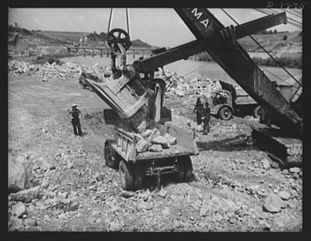 Tennessee Valley Authority. Construction of Douglas Dam. Loading out rock for crushing into aggregate for concrete work at the TVA's new Douglas Dam on the French Broad River. This dam will be 161 feet high and 1,682 feet long, with a 31,600 acre reservoir area extending forty-three miles upstream. With a useful storage capacity of approximately 1,330,000 acre-feet this reservoir will make possible the addition of nearly 100,000 kilowatts of continuous power to the Tennessee Valley Authority system in dry years and almost 170,000 kilowatts in the average year