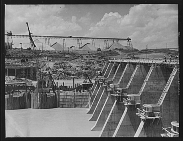 Tennessee Valley Authority power and conservation. Fort Loudoun Dam construction. Downstream face of Fort Loudoun Dam spillway with aggregate storage pile in the background. The new Fort Loudoun Dam is furthest upstream of the TVA's main Tennessee River projects. Scheduled for closure and first storage of water early in 1943, this dam will create a 15,000-acre lake reaching fifty-five miles upstream to the city of Knoxville. The reservoir will have a useful storage capacity of 126,000 acre-feet. Power installation of 64,000 kilowatts is authorized, with a possible ultimate of 96,000 kilowatts