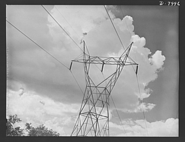 Tennessee Valley Authority. Transmission line towers and high-tension lines that carry current generated at the TVA's hydroelectric plant at Wilson Dam. Located near Sheffield, Alabama, 260 miles above the mouth of the Tennessee River, the dam has an authorized power installation of 288,000 kilowatts, which can be increased to a possible ultimate of 444,000 kilowatts. The reservoir at the dam adds 377,000 acre-feet of water to controlled storage on the Tennessee River system