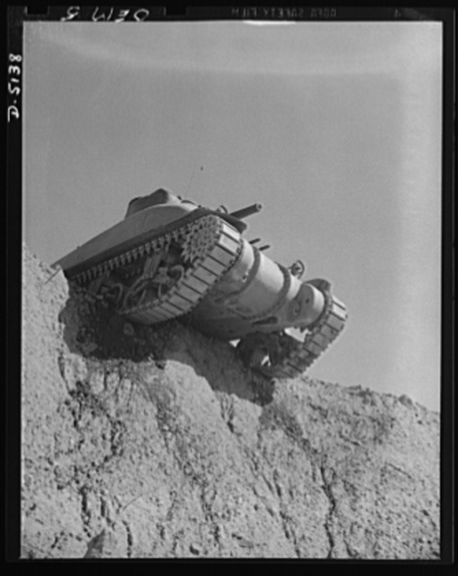Testing M-4 tanks. A battleship of the land, one of America's mighty M-4 tanks, tops the ridge of a test hill as trial runs are made at an Eastern manufacturing plant