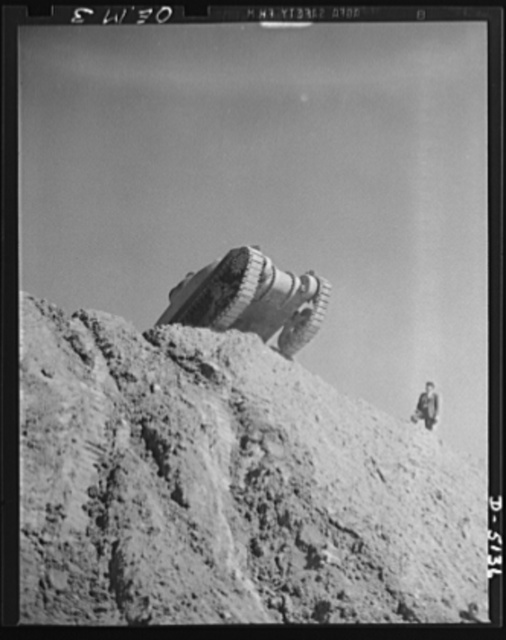 Testing M-4 tanks. A battleship of the land, one of America's mighty M-4 tanks tops the ridge of a test hill as trial runs are made at an Eastern manufacturing plant