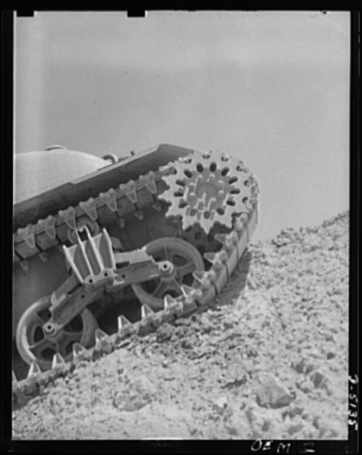 """Testing M-4 tanks. A mighty flow of power is carried to the """"track"""" by a driving sprocket of an M-4 tank in a trial run over the test hill of an Eastern manufacturing plant"""