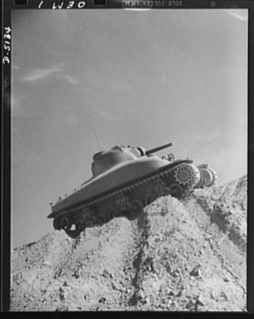 Testing M-4 tanks. One of America's new traveling forts, an M-4 tank, makes a trial run over the test hill of an Eastern manufacturing plant