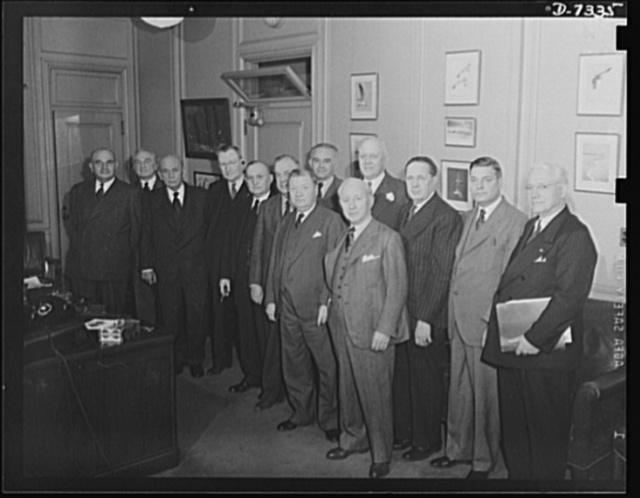 The committee of railroad presidents and railroad union officials forming the Railway Labor Management Conference held a session in Washington, December 18, 1942 with Office of Defense Transportation officials to discuss manpower problems. The group agreed to submit recommendations to the ailroad executives' associations and the railway labor organizations. Reading from left to right are J.J. Pelley, President, Association of American Railroads; E.E. Norris, President, Southern Railway System; L.W., Baldwin, Chief Executive Officer, Missouri Pacific Lines; S.J. Hogan, President, National Marine Engineers Association; E.W. Scheer, President, Reading Railway System; Joseph B. Eastman, Director, Office of Defense Transportation; J.G. Luhrsen, Executive Secretary, Railway Labor Executives' Association; O.S. Beyer, Director, Division of Transport Personnel; D.B. Robertson, President, Brotherhood of Locomotive Firemen and Enginemen; M.W. Clement, President, Pennsylvania Railroad; B.M. Jewell, President, Railway Employees' Department; G.M. Harrison, President, Brotherhood of Railway and Steamship Clerks; A.F. Whitney, President, Brotherhood of Railroad Trainmen