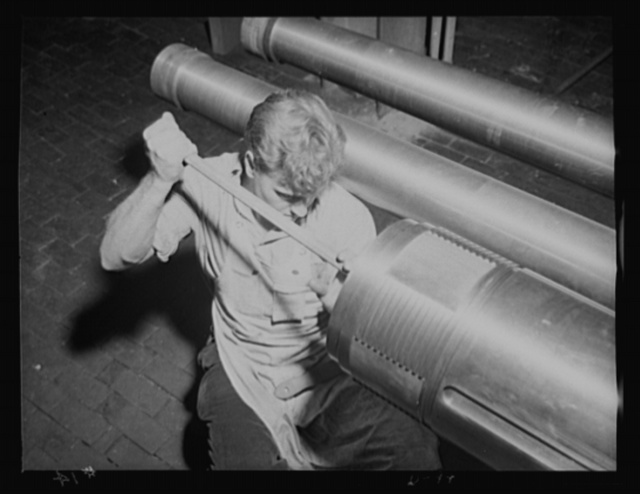 The man behind the gun. Worker in an eastern arsenal finishing up the breech end of a tube of a medium-caliber gun for the war program