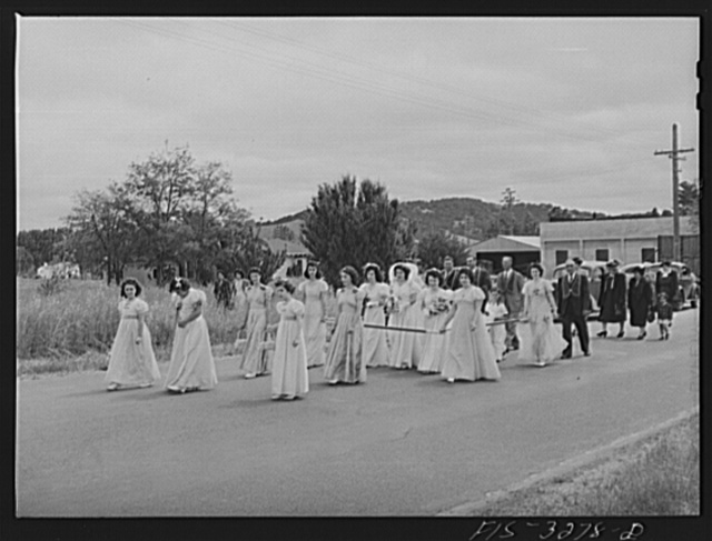 The Queen of the Holy Ghost Festival and her court as they go to church for special Mass. Novato, California