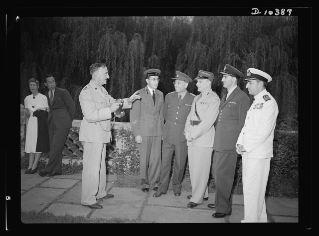 The uniforms are different but the cause is the same. Officers of the United Nations attend a garden party of the United Nations Club at Dumbarton Oaks, Sunday, September 6, 1942. Left to right: Lieutenant Colonel Sutton, Australia; Major Barayev, Assistant Military Attache, Russian Embassy; Colonel O. Spaniel, Czecholslovakia; Major Stefan M. Dobrowolski, Assistant Military Attache, Polish Embassy; Major M. V. Mishovich, Assistant Military Attache, Yugoslavia; Captain Alfred Leondopoulos