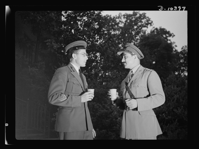 The uniforms are different but the cause is the same. Officers of the United Nations attend a garden party of the United Nations Club at Dumbarton Oaks, Sunday, September 6th, 1942. Left to right: Major Barayev, Assistant Military Attache, Russian Embassy; Captain Chaudhuri, Military Aide to the Agent General for India