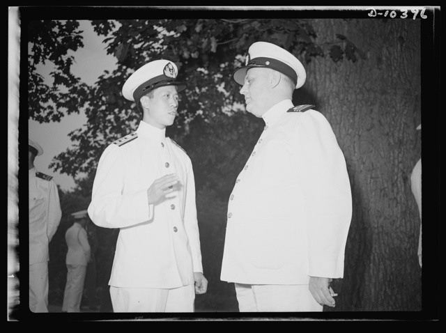 The uniforms are different but the cause is the same. Officers of the United Nations attend a garden party of the United Nations Club at Dumbarton Oaks, Sunday, September 6th, 1942. Left to right: Lieutenant Commander Y. C. Yang, China; Commander J. Blaauboer, Royal Dutch Navy Reserve, Assistant Naval Attache