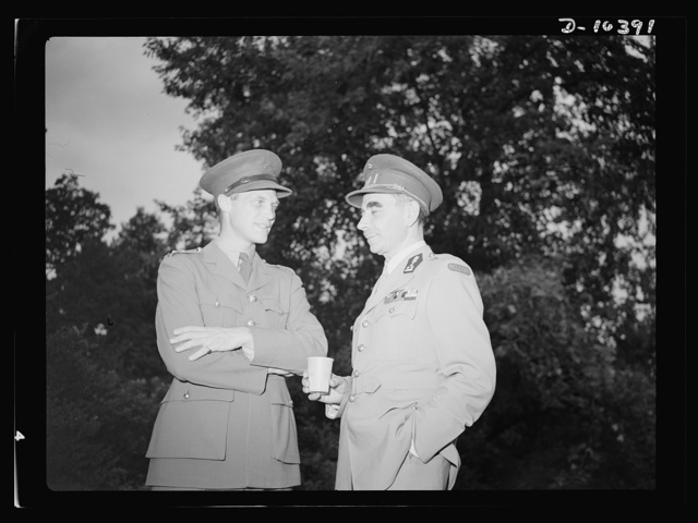 The uniforms are different but the cause is the same. Officers of the United Nations attend a garden party of the United Nations Club at Dumbarton Oaks, Sunday, September 6, 1942. Left to right: Colonel Drury, Royal Canadian Artillery; Colonel B. E. M. Diepenryck