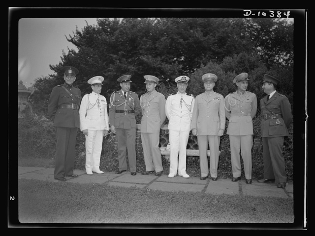 The uniforms are different but the cause is the same. Officers of the United Nations attend a garden party of the United Nations Club at Dumbarton Oaks, Sunday, September 6, 1942. Left to right: Colonel Felix Castellano, Military Attache, Guatemala; Lieutenant Colonel Felipe Munilla, Cuba; Colonel Hermogenes Prado, Nicaragua; St.  Colonel J. C. Velasquez, Philippines; Captain Felipe Cardenas, Cuba; Major General Basilio Valdes, Philippines;  Colonel Manolo Nieto, Philippines; Major Herman Baron, Military Attache, El Salvador