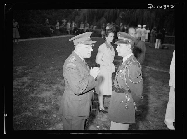 The uniforms are different but the cause is the same. Officers of the United Nations attend a garden party of the United Nations Club at Dumbarton Oaks, Sunday, September 6, 1942. Left to right: Colonel O. Spaniel, Czechoslovakia; Colonel R. B. Larouche, Military Attache Haitian Legation