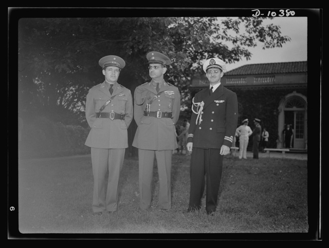 The uniforms are different but the cause is the same. Officers of the United Nations attend a garden party of the United Nations Club at Dumbarton Oaks, Sunday, September 6, 1942. Left to right: Lieutenant Colonel P.A. Jose Perez Allende, Mexican Air Corps; General Sanchez Hernandez, Mexico; Lieutenant Sagarra, Mexican Navy