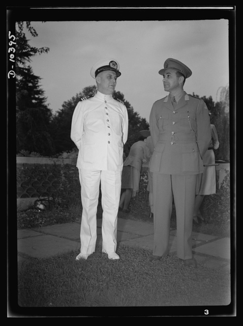The uniforms are different but the cause is the same. Officers of the United Nations attend a garden party of the United Nations Club at Dumbarton Oaks, Sunday, September 6th, 1942. Left to right: Commander J. Blaauboer, Royal Dutch Navy Reserve, Assistant Naval Attache; Lieutenant W. Van der Weyde, Royal Netherlands Army Reserve