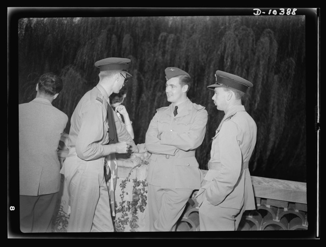 The uniforms are different, but the cause is the same. Officers of the United Nations attend a garden party of the United Nations Club at Dumbarton Oaks, Sunday, September 6, 1942. Left to right: Squadron Leader Lowry, Royal Air Force; Miss Barbara Brady; Pilot Officer James, RAF (Royal Air Force); Squadron Leader Lee, RAF