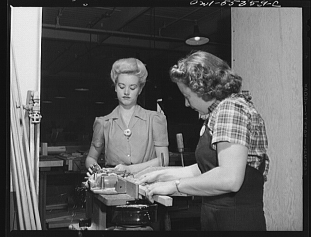 These two women employees in North American's wood shop run a planer