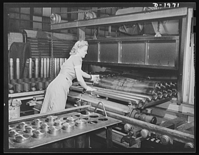 Three-inch A.A. cartridge cases. Loading antiaircraft cartridge cases into a stress-annealing furnace to make them soft, uniform and ductile, ready for succeeding machine operations. The equipment possessed by this big Midwest plant was well suited for producing these cases in large volume