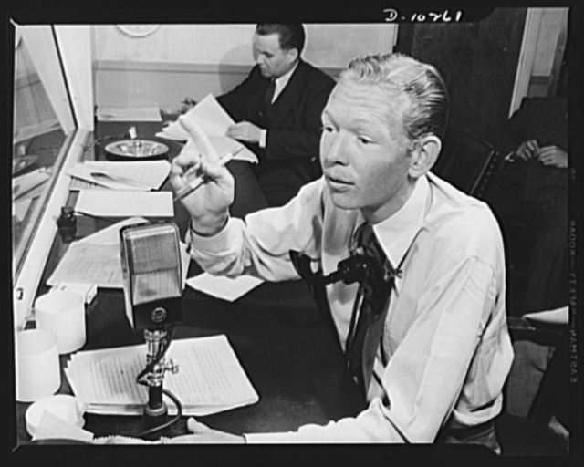 Three Thirds of the Nation. From his post in the Blue Network control room, Sam Pierce, director of the War Production Board (WPB) radio program Three Thirds of the Nation, cues actors during presentation of the show