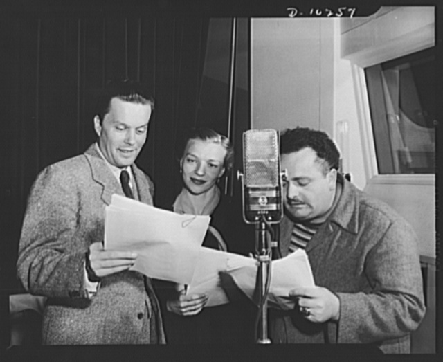 Three Thirds of the Nation. Left to right: Lou Merrill, Lucille Meredith and Eric Rolf rehearsing for thw War Production Board (WPB) radio program, Steel, presented May 6 over the Blue Network