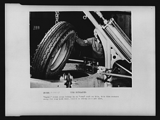 """Tire retreading. """"Cured,"""" which means baking in an oven such as this, this tire emerges ready for long, hard wear almost as strong as a new tire"""