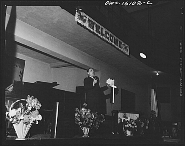 Toledo, Ohio. Evangelical church ceremony at which the preacher delivered a hysterical speech, and then burned a copy of Hitler's Mein Kampf. Preacher holding forth
