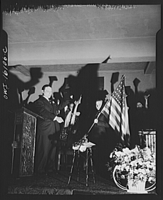 Toledo, Ohio. Evangelical church ceremony at which the preacher delivered a hysterical speech, and then burned a copy of Hitler's Mein Kampf. Preacher with the Bible, Mein Kampf burning, and a boy with the American flag