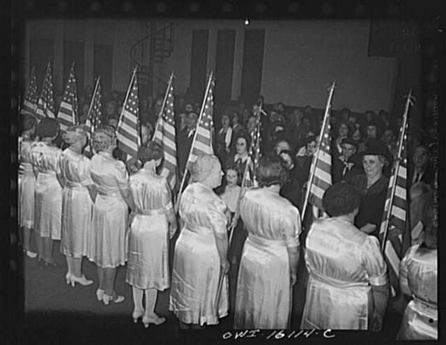 Toledo, Ohio. Evangelical church ceremony at which the preacher delivered a hysterical speech, and then burned a copy of Hitler's Mein Kampf. Sisters in satin dresses carrying American flags