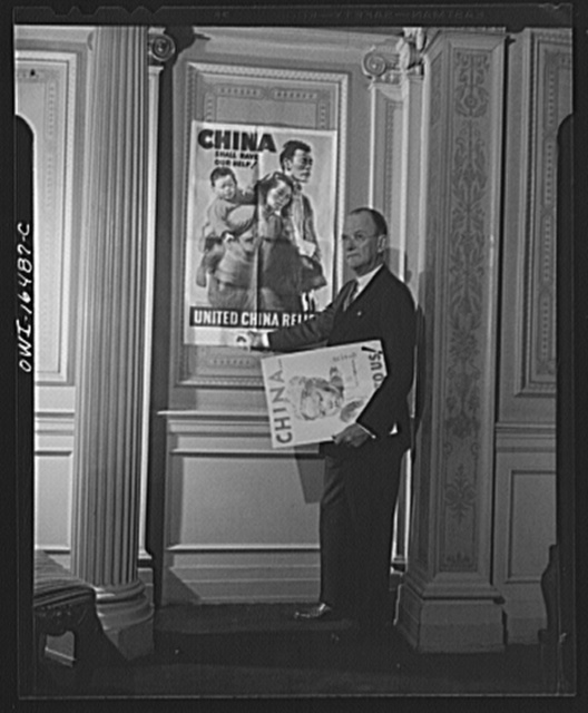 Toledo, Ohio. Ward Canaday, a millionaire, head of China Relief in Toledo, with a Chinese war relief poster
