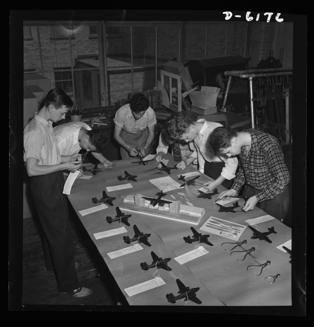 Training high school boys to identify planes. Student's test model planes for accuracy of specification, in a basic aviation course given at Weequahic High School, Newark, New Jersey