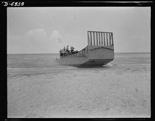 Training. Ramp boats. A fifty-foot steel ramp boat capable of landing tanks and large forces of men at beach positions. The large gate-like section facing the beach is hinged to drop forward on the sand and form a ramp for the passage of men and equipment. The Southern shipyard that makes these boats cooperates in the training of crews