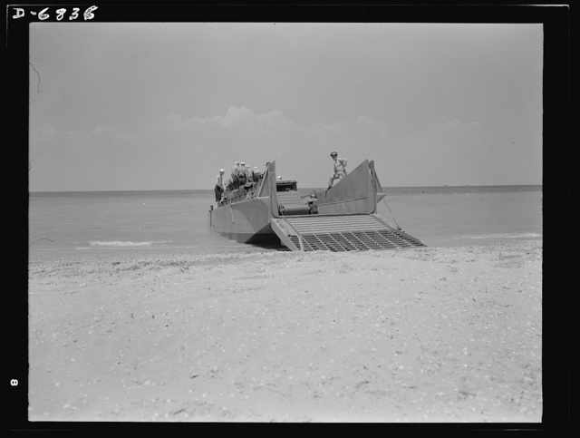 Training. Ramp boats. The Marines prepare to set a truck ashore from a fifty-foot ramp boat at a Navy school conducted by the Southern shipyard at which the boat was made. When the ramp is raised it closes tightly against the boat, making it entirely seaworthy. Higgins Industries