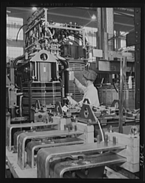 Transformer manufacture. Before transformer coils are wound, condenser plates must be inspected. These transformers are vital to war production and are used to produce power in almost every phase of America's war effort. Westinghouse, Sharon, Pennsylvania