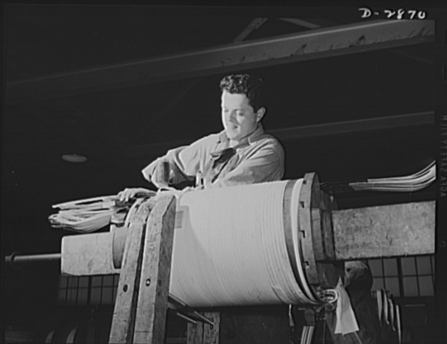 Transformer manufacture. It's a formidable task, but Jack Hassel can wind one of these asbestos insulated low volts coils in a day. Essential to America's war efforts, these asbestos coils are used in air cooled transformers which are explosion-proof, hence advantageous for use in ships, mines and large buildings. Westinghouse, Sharon, Pennsylvania