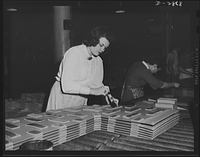 Transformer manufacture. Preparation of insulating board used between copper coils on distribution transformers is done by women employees of a large Eastern electrical company. These young women are extremely valuable to Uncle Sam, because the product they are making is used in almost every phase of the armament program. Westinghouse, Sharon, Pennsylvania