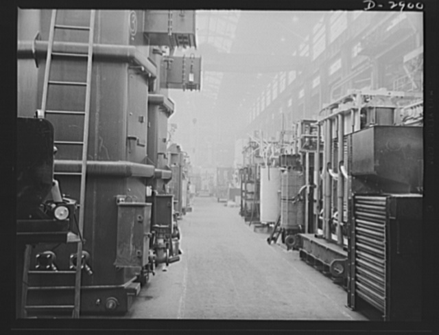 Transformer manufacture. Ready to be sent to aluminum and magnesium plants are these power transformers manufactured by a large Eastern electrical company. Along this aisle of the plant, are other transformers in every stage of manufacture. They are essential to almost every phase of Uncle Sam's war production effort. Westinghouse, Sharon, Pennsylvania