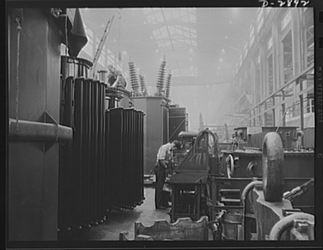 Transformer manufacture. These large transformers are being prepared for testing in a large Eastern plant given over almost entirely to the manufacture of transformers. Transformers are vital to almost every phase of war Production. Westinghouse, Sharon, Pennsylvania