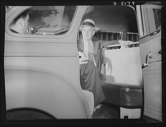 Transportation. War workers' coach. Joseph B. Eastman, Director of the Office of Defense Transportation, inspects a new fifteen-passenger war workers' coach made from a standard five-passenger light sedan with the use of only 300 additional pounds of steel