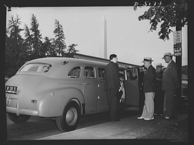 Transportation. War workers' coach. Joseph B. Eastman, Director of the Office of Defense Transportation, inspects a new fifteen-passenger war workers' coach made from a standard five-passenger sedan with the use of only 300 additional pounds of steel. Left to right: Francis W. Feeney, president of the Fitz John Coach Company, which made the vehicle; Mr. Eastman; Frank H. Shepard, Special Assistant in the Office of Defense Transportation's Local Transportation Division; Guy A. Richardson, Director of the Local Transportation Division