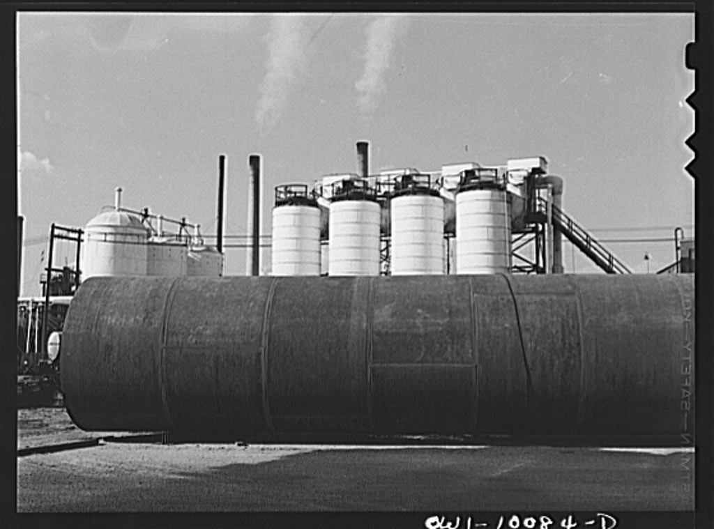Tulsa, Oklahoma. Assembled tower sections and chiller tanks at the Mid-continent refinery