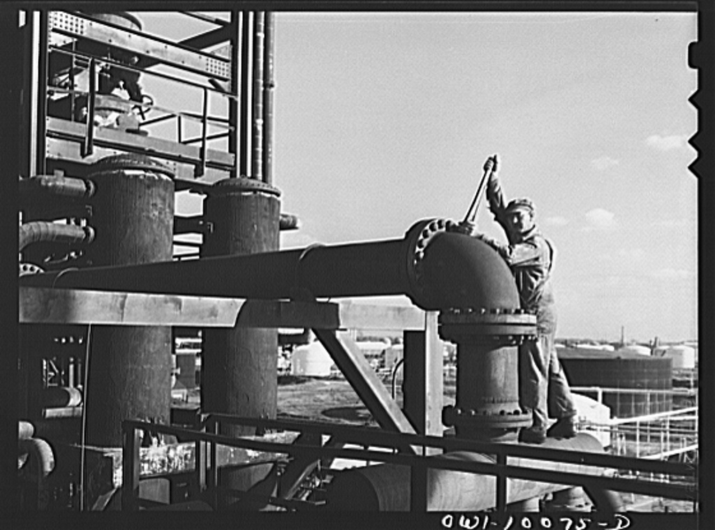 Tulsa, Oklahoma. Employee at a crude pipe still at the Mid-continent refinery