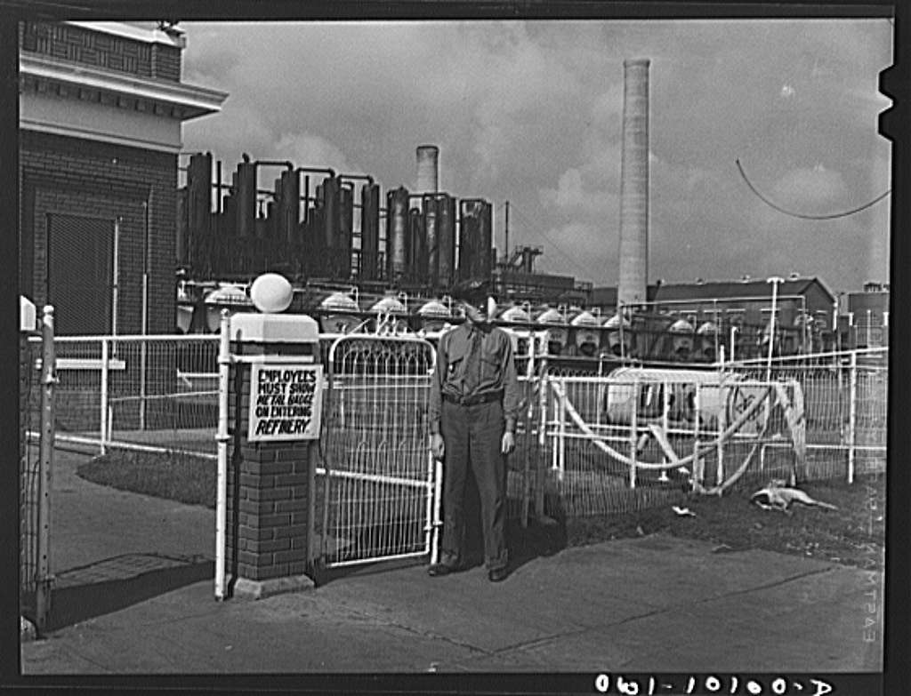 Tulsa, Oklahoma. Guard at the employees entrance to the Mid-continent refinery