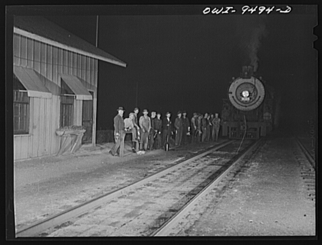 Tulsa, Oklahoma. Railroad men on the night shift in front of the station master's office
