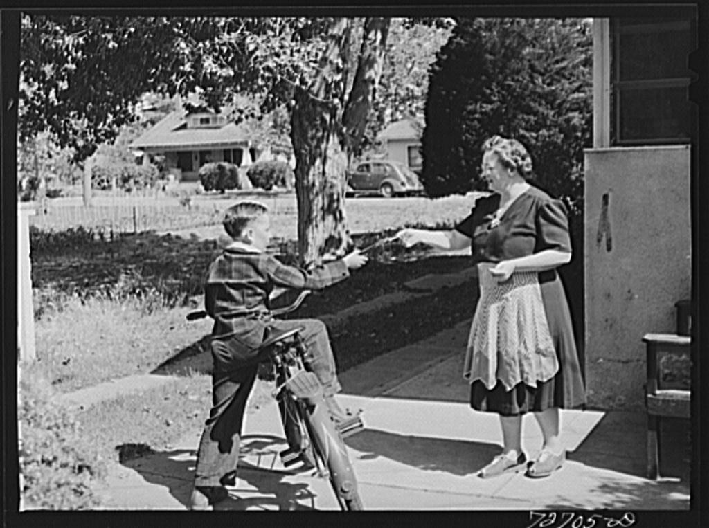 Turlock, California. Housewife sending her son off to school