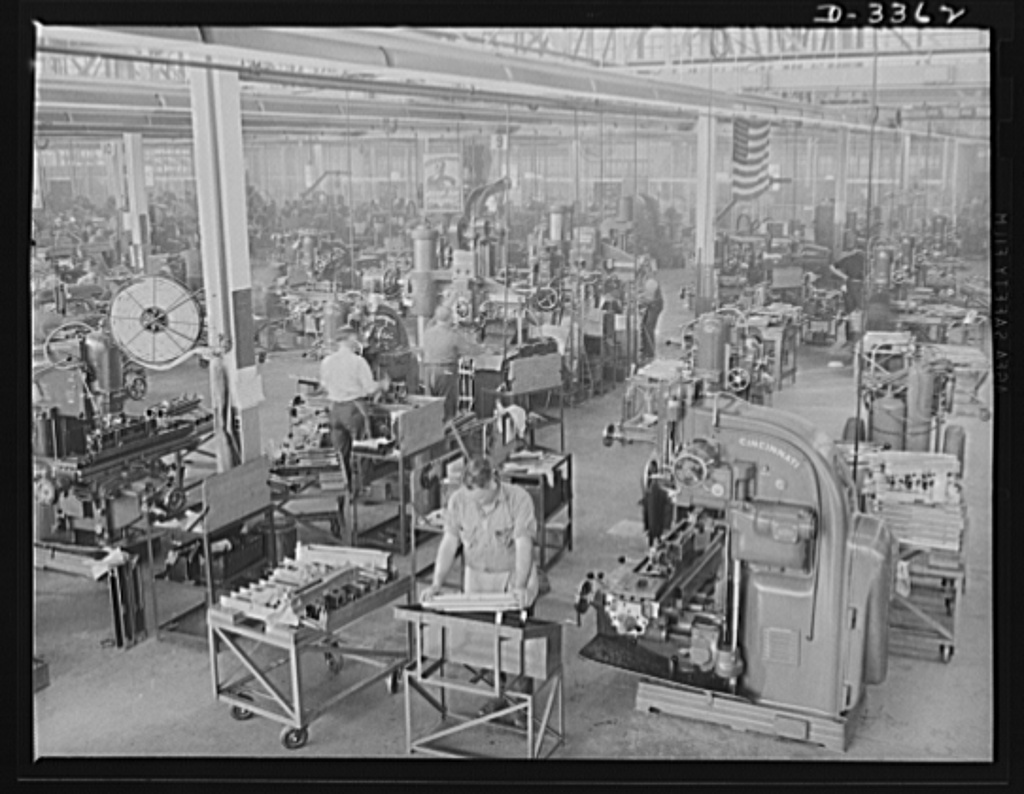 Twenty-millimeter machine guns for planes. A big automobile plant, now entirely on war production, has a well-equipped department for the finishing of breeches for Air Corps machine guns. Milling, grinding and other machine operations are handled as expertly as in the days when the plant was making automobile parts. Oldsmobile, Lansing, Michigan
