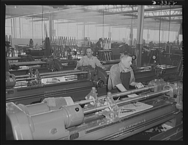 Twenty-millimeter machine guns for planes. Since the days of early American gunsmiths, our arms manufacturers have taken pride in the quality of their work. Today, a skilled worker in a converted auto plant feels that same pride as he bores a machine gun barrel for Air Corps. Oldsmobile, Lansing, Michigan