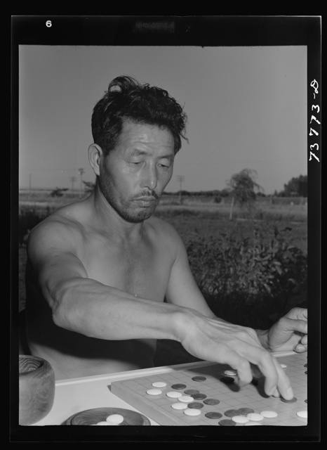 """Twin Falls, Idaho. FSA (Farm Security Administration) farm workers' camp. Japanese farm workers play game of """"Go"""""""